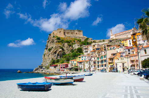 Fishing colorful boats on sandy beach, Scilla, Calabria, Italy