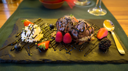 Italian desert with ice cream, tartufo, raspberry, strawberry and chocolate